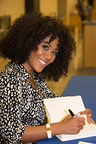 Miko Branch signs copies of her book in D.C.